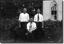 Bill Hart, Charley Stevens, and Frank Green in 1920 standing outside of church