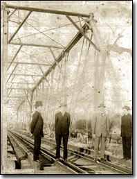 Bill Hart McNesby and Tabor Stamper (L-R) at the railroad bridge in Farmers, KY
